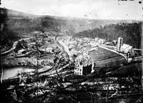 Historic photograph of Coalbrookdale showing the industrial buildings, the church and some houses