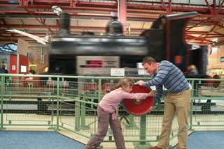 Enginuity- families work and play together to move the giant loco