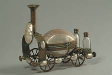 Vanity set in the shape of a steam locomotive, made from 13 nautilus shells mounted on brass.