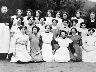 Copy of original postcard showing group portrait of paintresses from Coalport China Works, seated on far left of centre row is Elizabeth Mary Morgan (`Liza') married name Gough