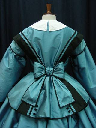 Reproduction fashionable dress 1850s worn by costumed staff.JPG