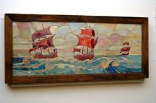 Rectangular tile panel showing 3 stylised galleons at sea, panel is made up of irregular shaped tiles decorated in lustre glazes, ships in red ruby lustre, sea blue and yellow, sky in silver yellow, red and yellow; manufactured by Craven Dunnill and Co., 1914 = 1930.